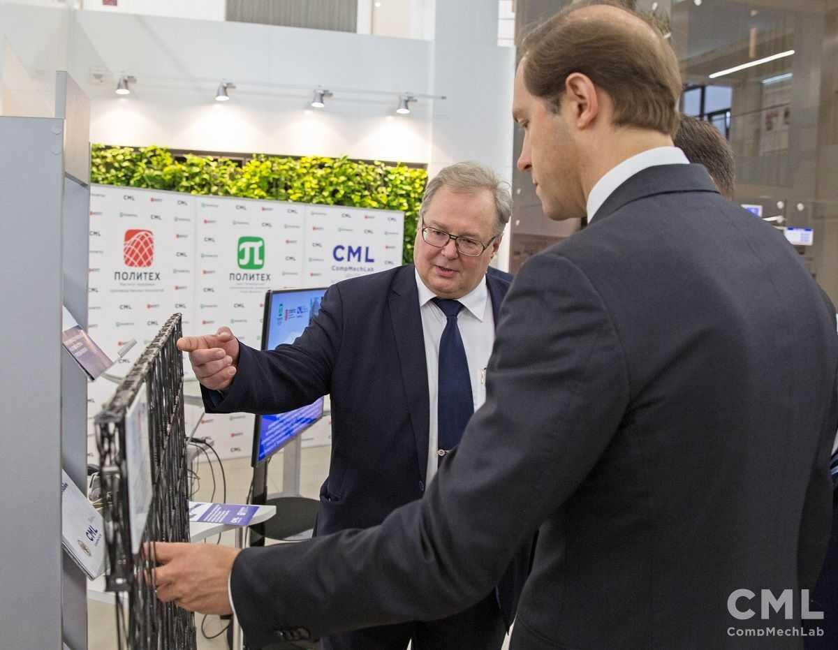 Alexey Borovkov, the head of SPbPU Computer-Aided Engineering Centre of Excellence (left) demonstrates composite panel to Denis Manturov, the Minister of Trade and Industry